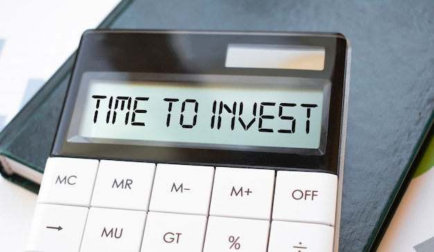 Word time to invest on calculator. business and finance concept.