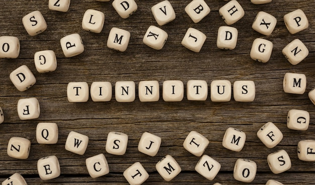 Word tinnitus written on wood block,stock image
