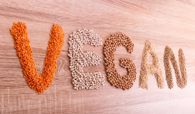 Word vegan made of lentils, buckwheat, beans, rice and chickpeas