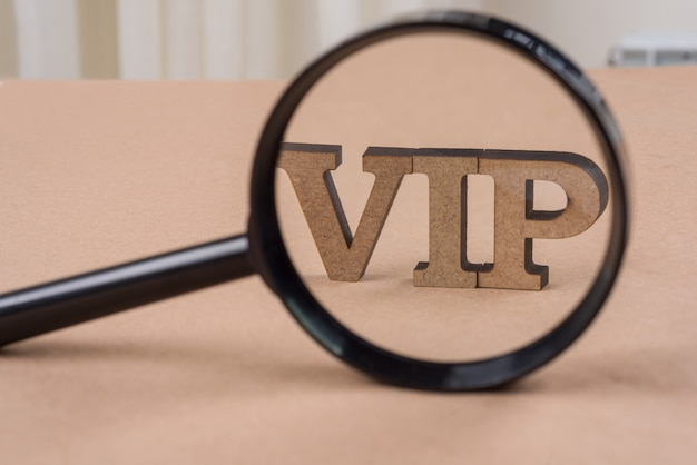 The word vip under a magnifying glass