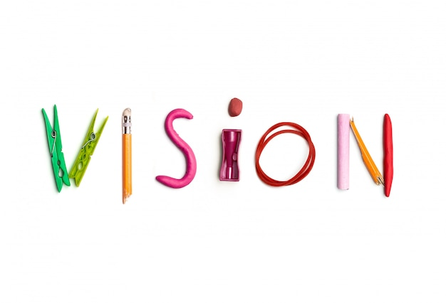 The word vision created from office stationery.