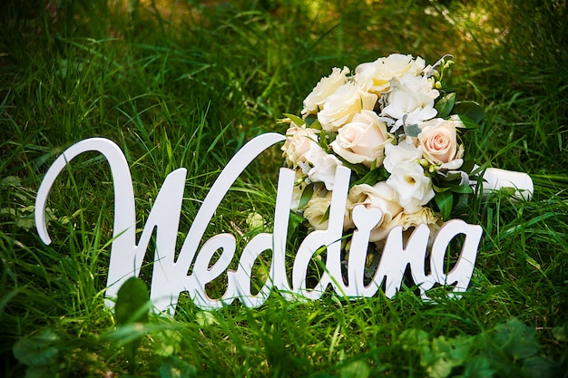 Word of wedding and bridal bouquet