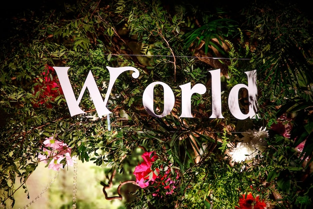 The word world surrounded by plants.