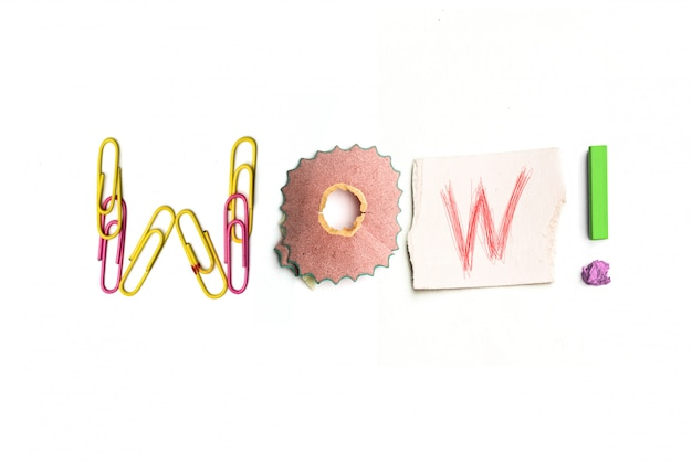 The word wow created from office stationery.