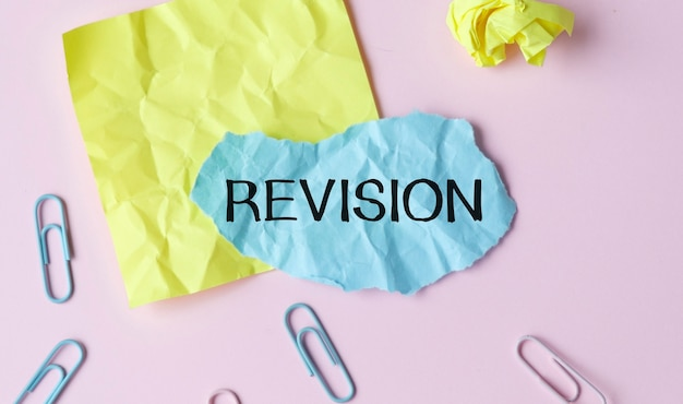 Word writing text revision. business concept for action of revising over someone like auditing or accounting red bubble copy space paper on the table.
