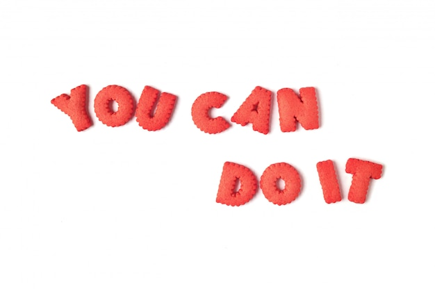 The word you can do it spelled with red colored alphabet shaped biscuits