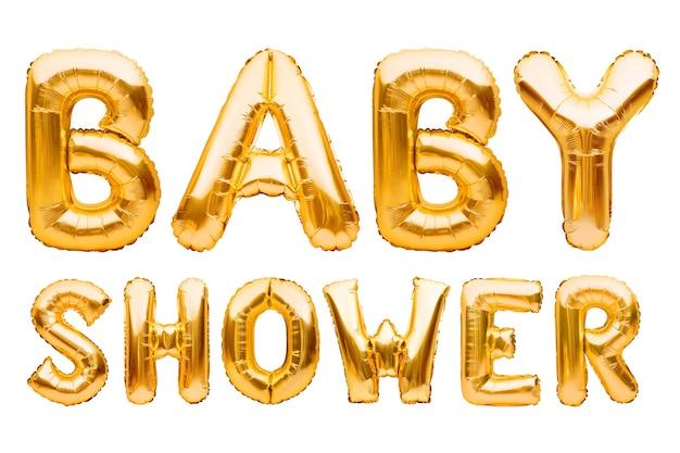 白い背景に分離された金色の膨脹可能な風船で作られた言葉のベビーシャワー装飾を祝うテキストの赤ちゃんの誕生日パーティーを形成するヘリウム箔の風船