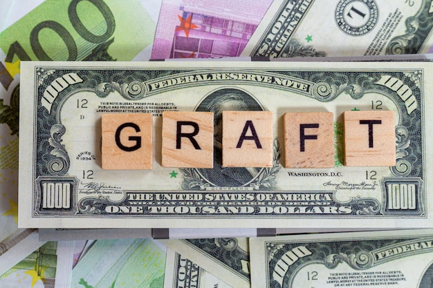 Words bribe, graft, corruption on the money banknotes