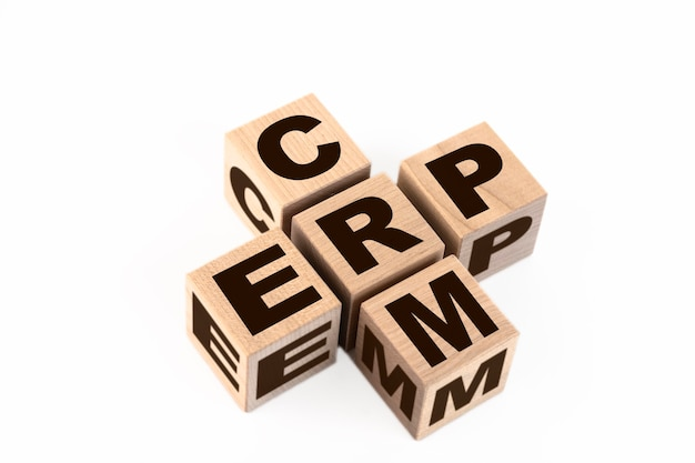 Words crm and erp collected in crossword with wooden cubes. erp enterprise resource planning, crm business customer crm management analysis service.