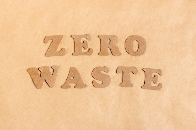 Words from letters zero waste cut out of cardboard of craft paper