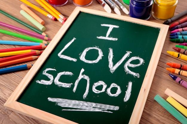 The words i love school written on a small elementary blackboard