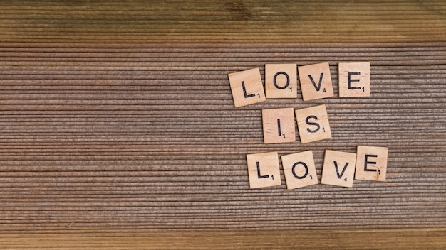 Words love is love from wooden elements