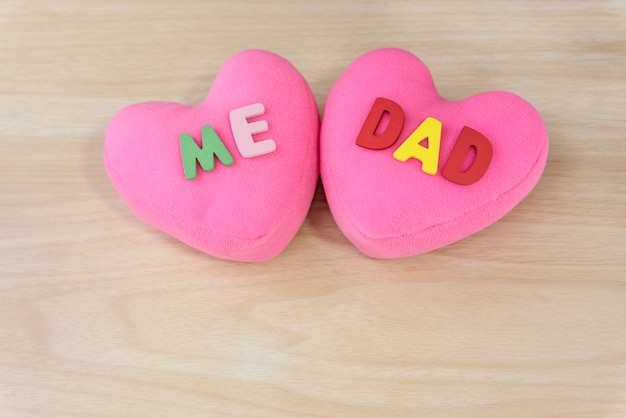 Words me and dad over pink heart