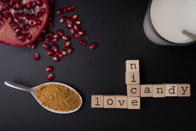 Words nice, candy and love, with the preparations of breakfast, milk, sugar and pomegranate