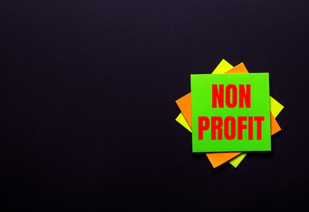 The words non profit on a bright sticker on a dark background