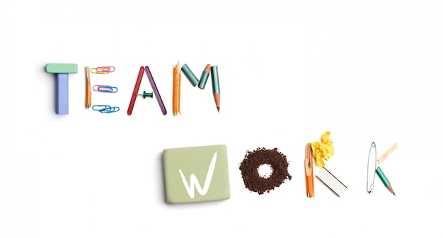 The words team work created from office stationery.