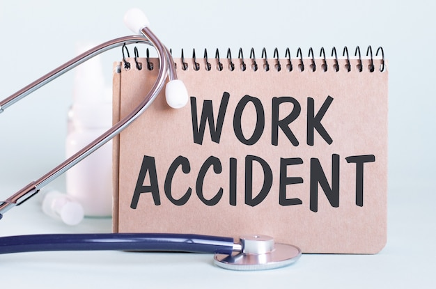 Work accident - diagnosis written on a white piece of paper
