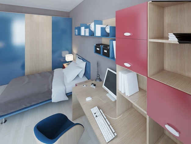 Work area in teenagers bedroom with light brown wood table with computer and wall system with accents of red and blue colors.