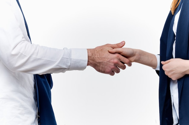 Work colleagues shake hands communication contract light background