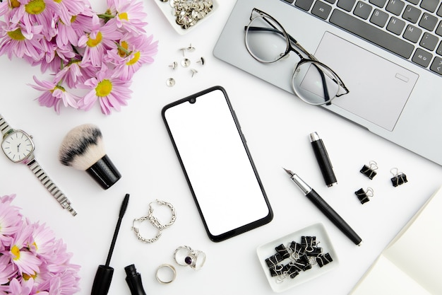 Work composition on white background with different devices and objects