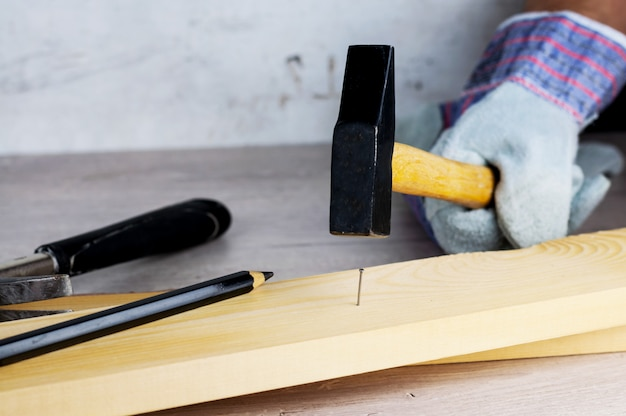 Work on the construction or repair of the house. independent update, renovation. use working gloves and a hammer.