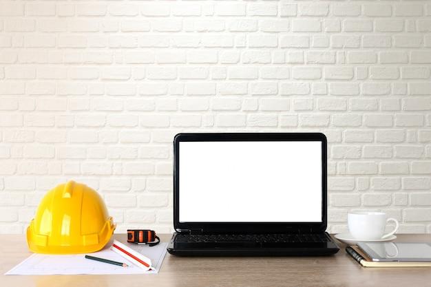 Work desk, building engineer, notebook, safety hat,