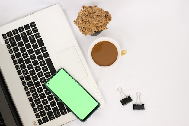 Work desk with a cup of coffee isolated on white background