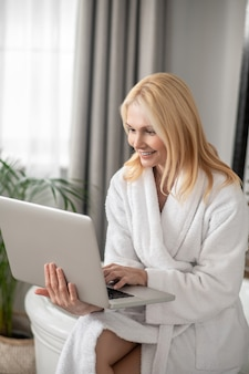 Work from home. long-haired blonde woman with a laptopworking from home