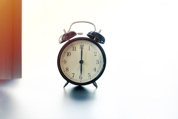 Work life balance concept alarm clock with copy space