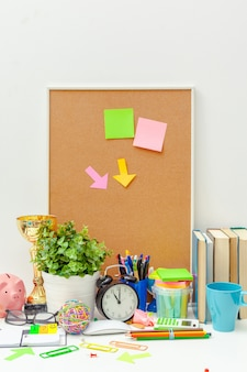 Work place of a creative person with a variety of colorful stationery objects
