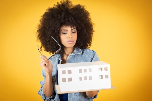 Work and profession. cheerful attractive young architect with afro hairstyle enjoying her occupation
