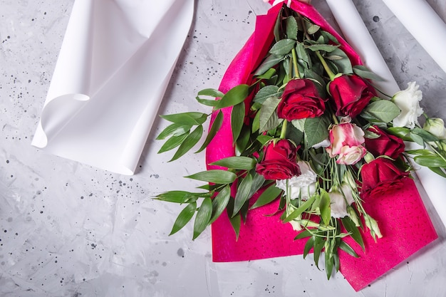 The work of a professional florist to create bouquets a