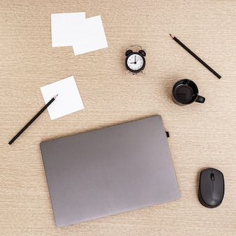 Work space and time management concept. start of freelancers working day. work from home under quarantine. laptop and time monitoring, nine clock in morning.