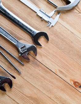 Work tools on a wooden floor. construction concept.