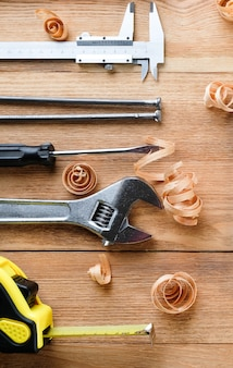 Work tools on a wooden table. construction tools on wooden boards. construction concept.