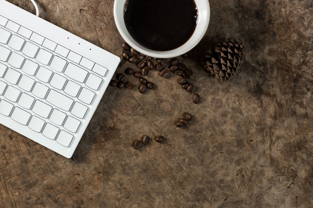 Work with the keyboard and have a coffee mug on the wooden floor.