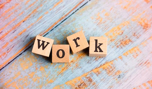 Work word written on wood block on timber board