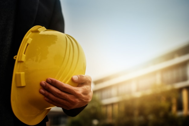 Worker architecture engineer hold hard hat helmet safety  for construction