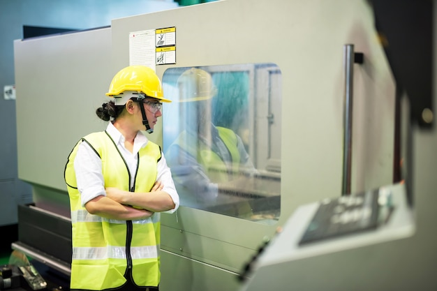 Worker checks factory machine production