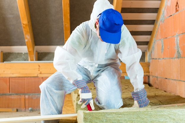 Worker cutting insulating material