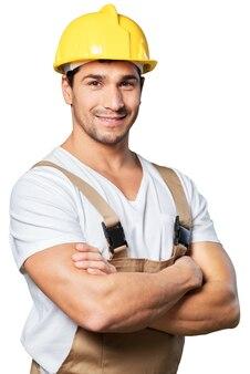 Рабочий парень веселый изолированный красивый мастер руководство