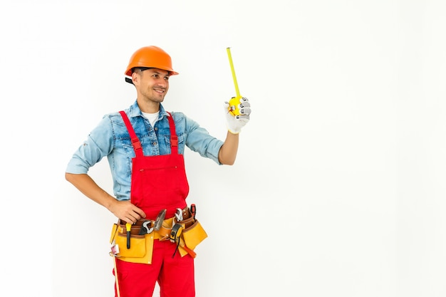 Worker on hard hat measure with ruler. isolated on a white.