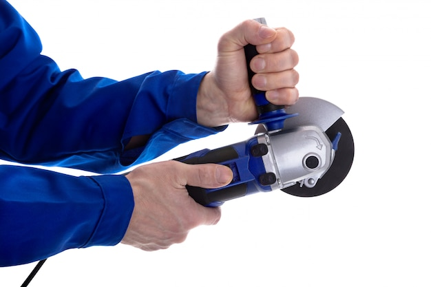 The worker holding angle grinder