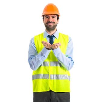 Worker holding something over white background
