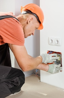 The worker is installs and connects the power supply of led backlight.