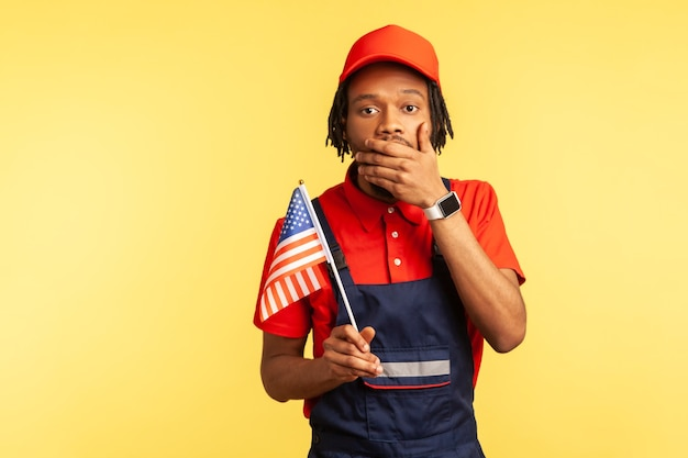Worker man holding usa flag closing mouth wi infringement of human rights