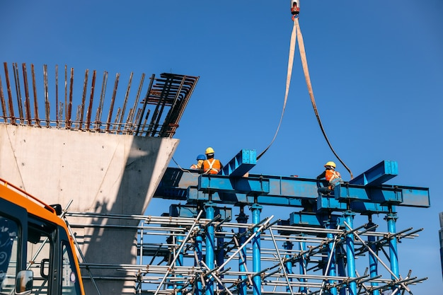 Worker on mega construction site of fly over or bridge project