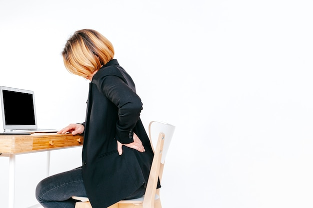 Worker of office having back ache