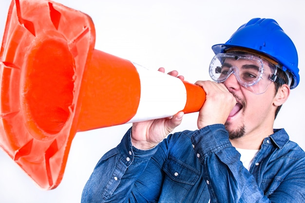 Worker shouting with a cone work isolated