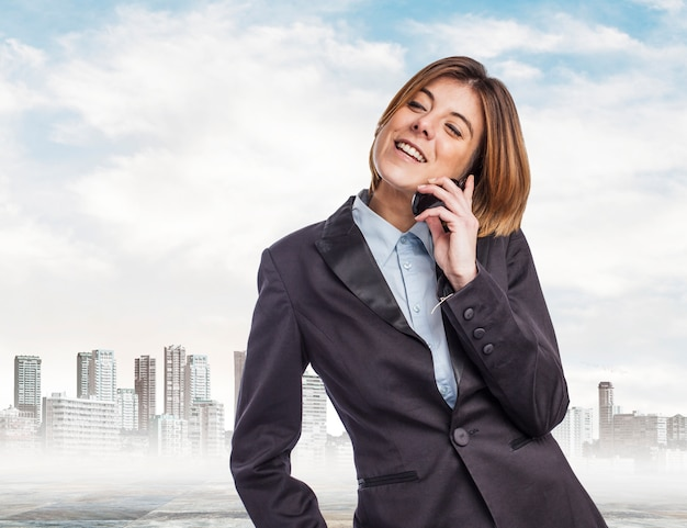 Worker talking on the phone with city background